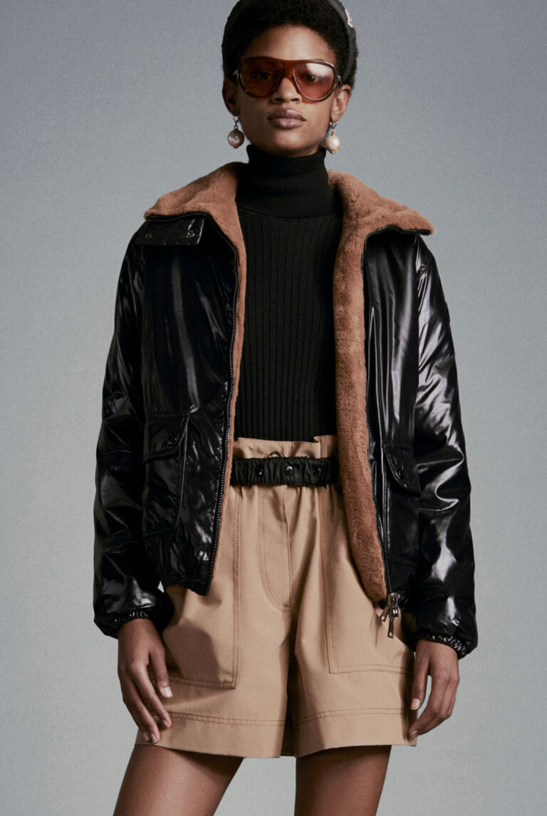 A women wearing the reversible jacket Moncler Adoxe