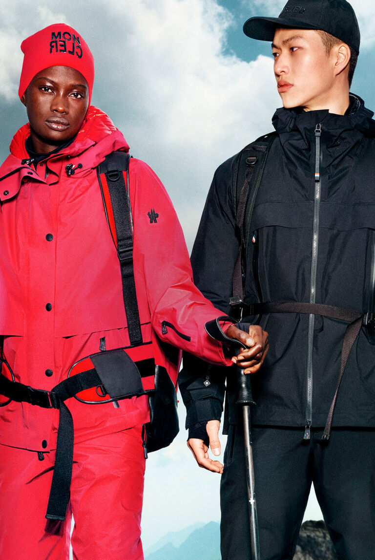 A woman and a man wearing jackets from the Moncler Grenoble Collection