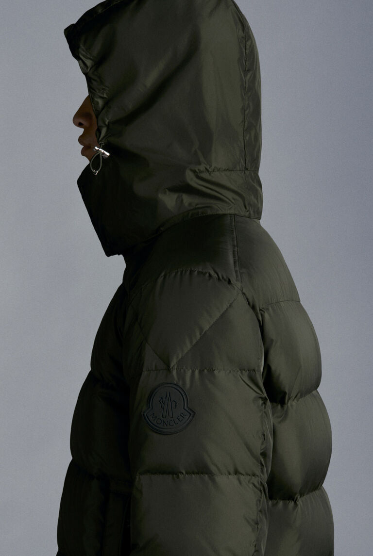 A men wearing a hooded Moncler Ground Roving down jacket