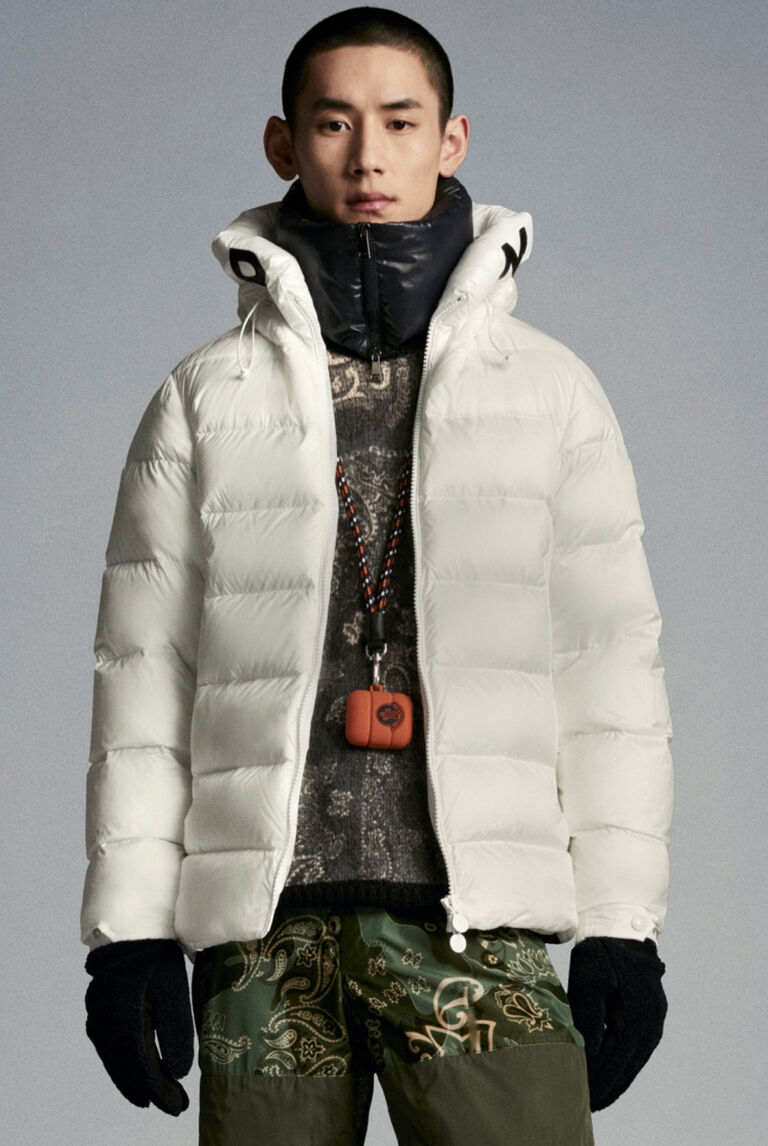 A man wearing Moncler Bandana Brink full outfit with white short down jacket