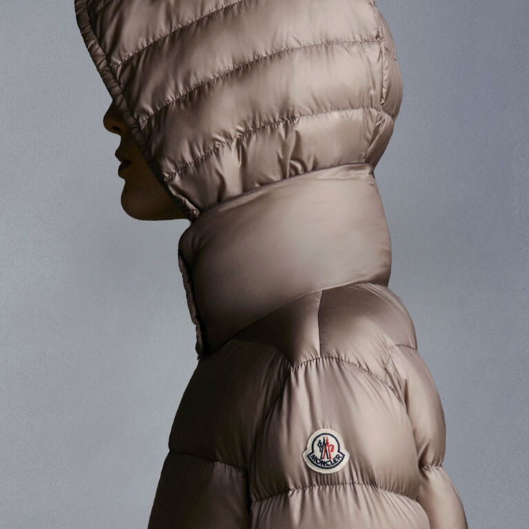 A woman wearing one of Moncler's pieces that add warmth