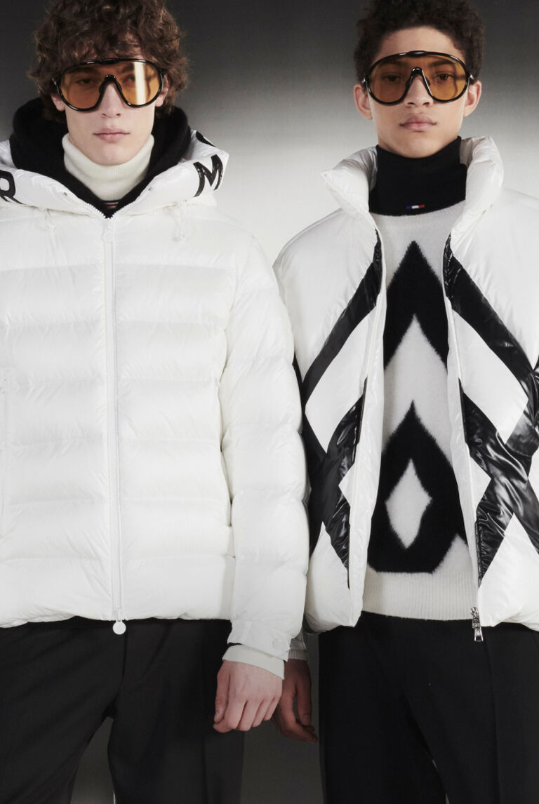 Three models wearing Moncler Vertex Form white down jackets