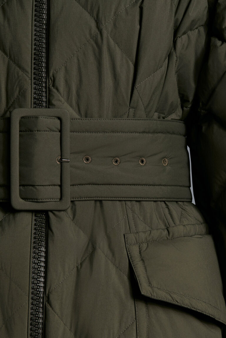 A detail of a green belted Moncler Camping Uniform down jacket