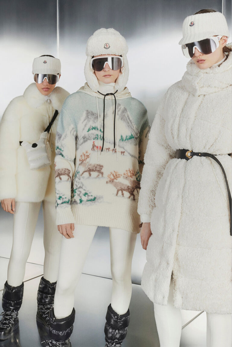 Four women wearing the Moncler Snow Globe Collection