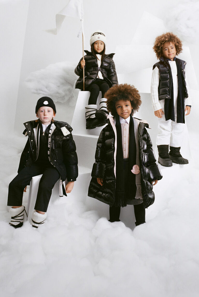 A group of children wearing Moncler down jackets, down coats and down gilets
