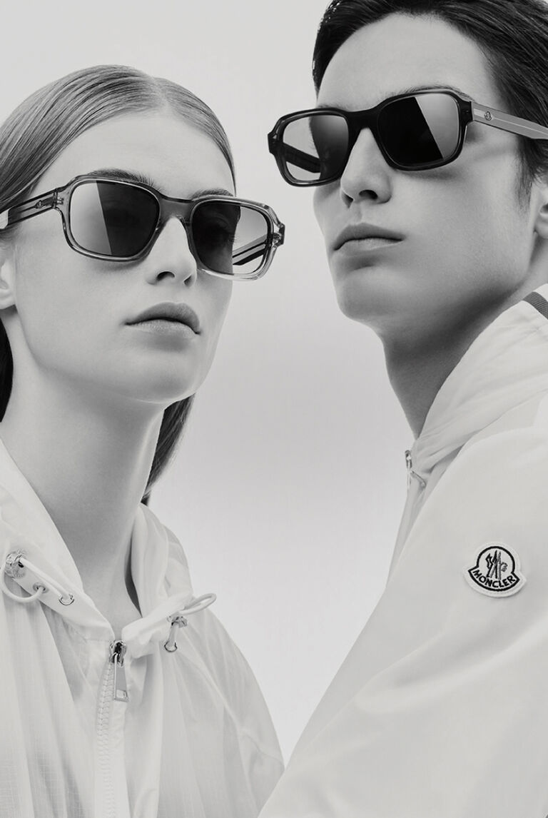 A man and a woman wearing Moncler sunglasses