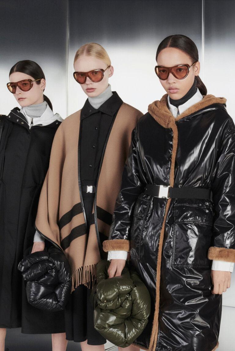 Five women wearing Moncler Upper Octane collection outerwear