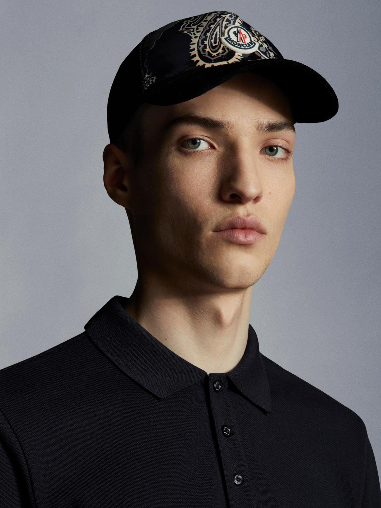 A man wearing a black hat Moncler