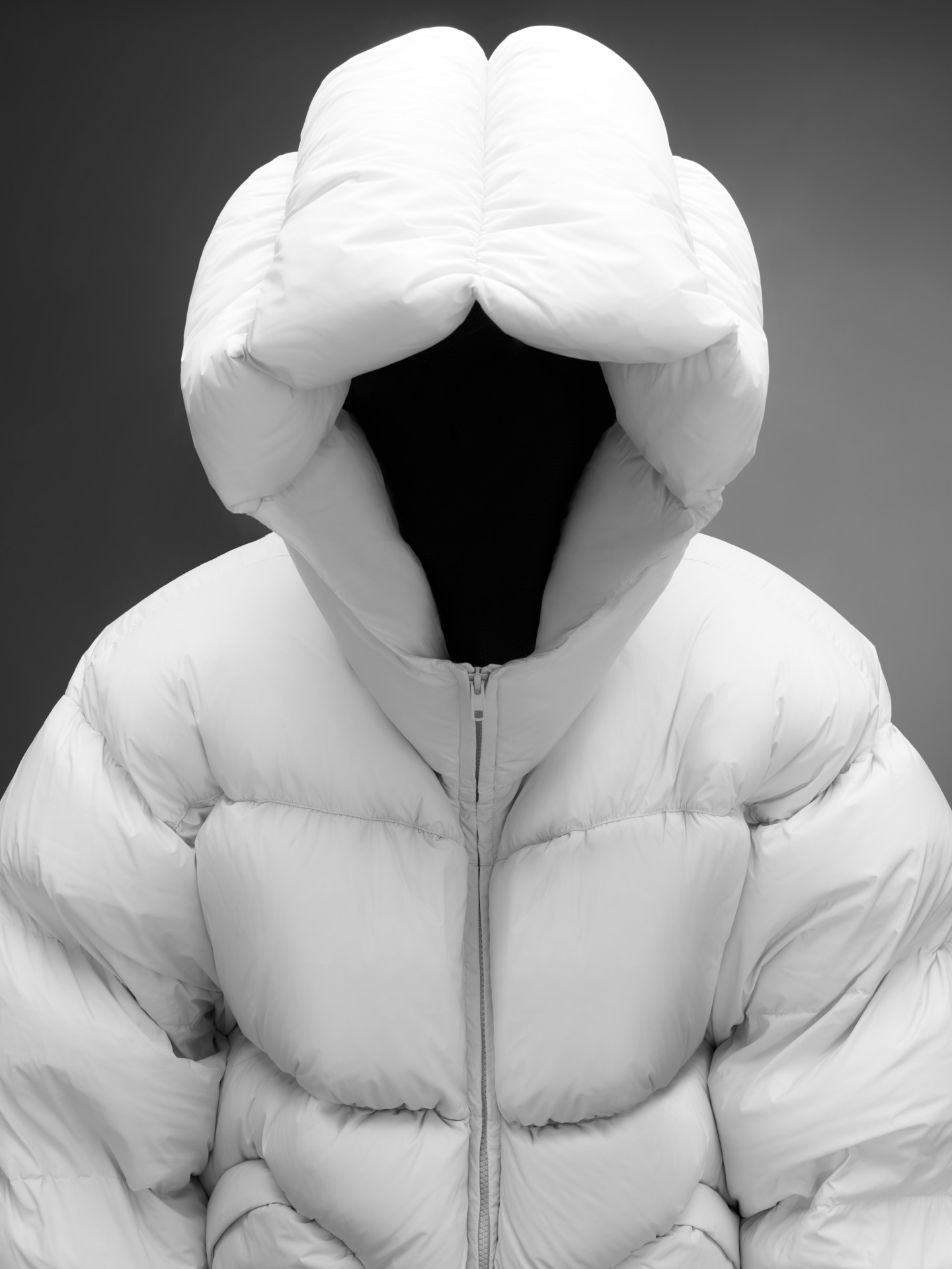 DINGYUN ZHANG - Black and white image of a Moncler down jacket